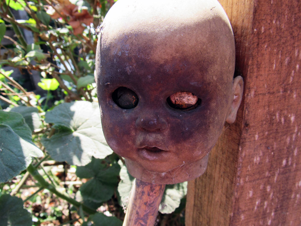 Doll head impaled