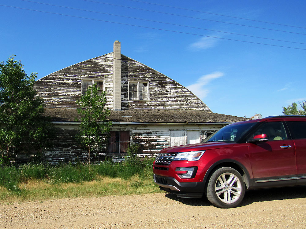 Ford in front of Barn