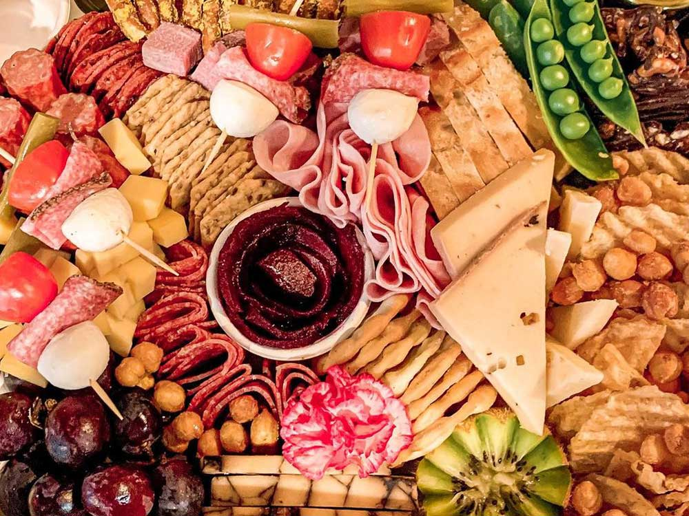 A charcuterie board of cheese, meat, olives and other delicious stuff.